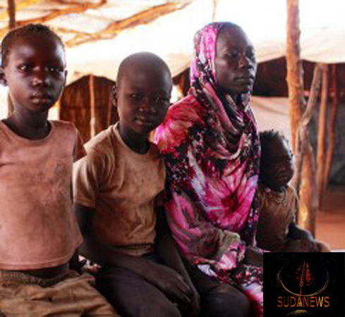 A refugee family from South Kordofan at a registration centre in Yida, South Sudan. Credit: UNHCR/K. Mahoney