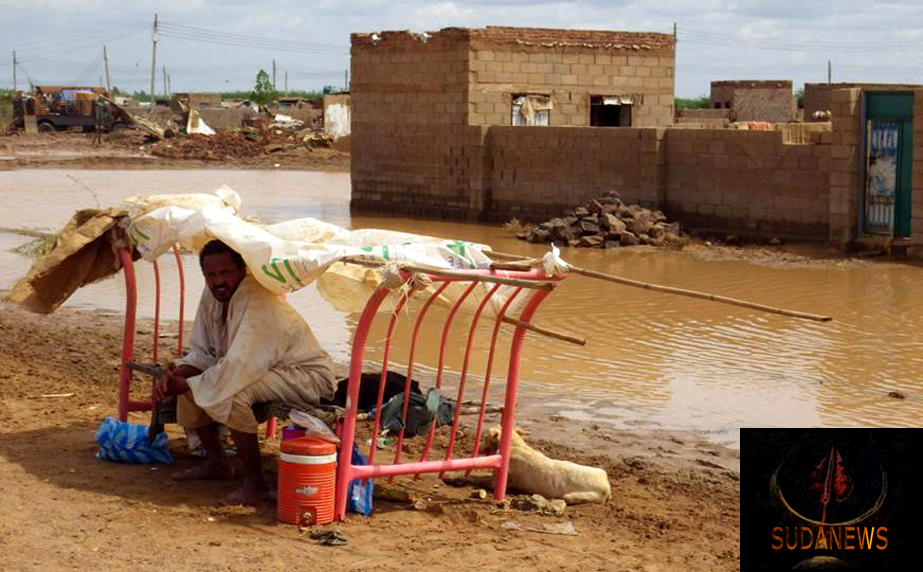 A man on a flooded street in Sharg al Nil Area, Khartoum. Photo: Rodraksa/OCHA