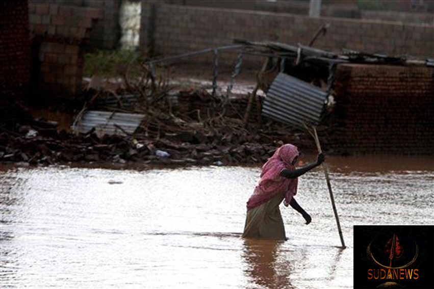 A Sudanese woman makes her way through flood water in Khartoum, Sudan, Aug. 6, 2013