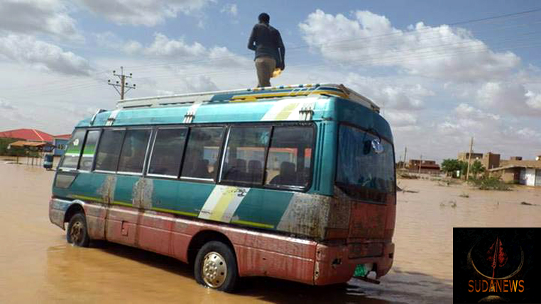 A man stands on a bus in the Sharg al Nil area of Khartoum, Sudan, where as many as 530,000 people may have been affected since the start of August 2013. Photo: OCHA/Rodraksa