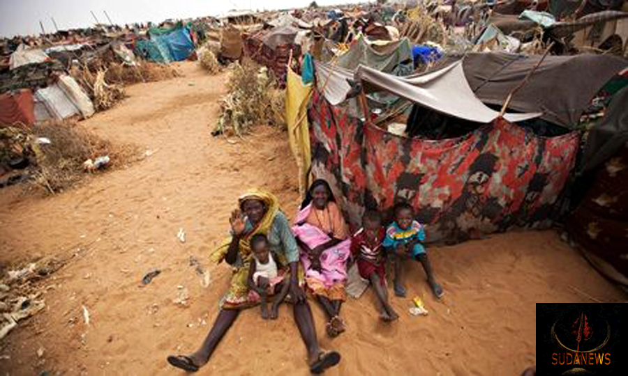Women and children sit outside tents at the Zam Zam refugee camp in north Darfur, Sudan, after fleeing militia attacks on their villages. Photograph: Albert Gonzalez Farran/AP