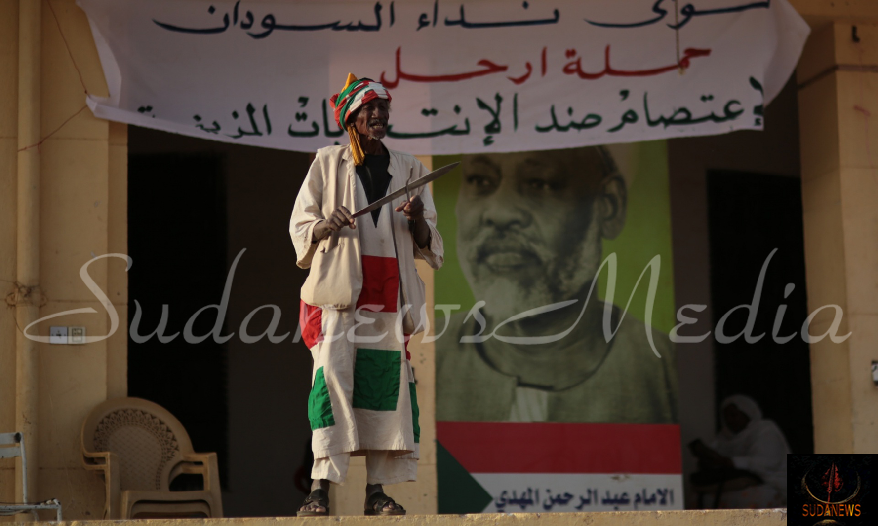 A participant of a sit-in at the HQ of opposition party Umma, calling for an election boycott. Photograph: Mosa'ab Elshamy/AP