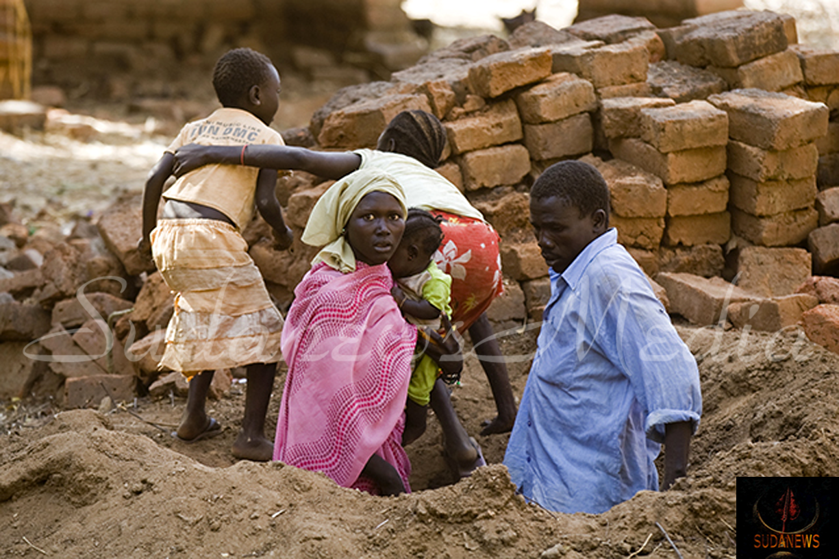 A family comes out from a foxhole where they hid when 12 bombs were dropped in Kauda town, destroying three houses, and injuring one man in Southern Kordofan, Sudan. © 2015 Giovanni Diffidenti